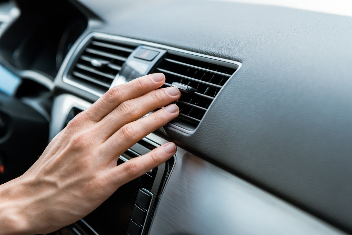 hand on car air conditioning vent